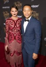 """LOS ANGELES, CA - MARCH 02: Model Chrissy Teigen and singer John Legend arrive for the world premiere of Disney's live-action """"Beauty and the Beast"""" at the El Capitan Theatre in Hollywood as the cast and filmmakers continue their worldwide publicity tour on March 2, 2017 in Los Angeles, California. (Photo by Jesse Grant/Getty Images for Disney) *** Local Caption *** Chrissy Teigen; John Legend"""