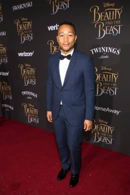 """LOS ANGELES, CA - MARCH 02: Singer John Legend arrives for the world premiere of Disney's live-action """"Beauty and the Beast"""" at the El Capitan Theatre in Hollywood as the cast and filmmakers continue their worldwide publicity tour on March 2, 2017 in Los Angeles, California. (Photo by Jesse Grant/Getty Images for Disney) *** Local Caption *** John Legend"""