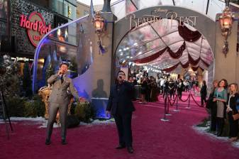 """Luke Evans, Josh Gad perform during the world premiere of Disney's live-action """"Beauty and the Beast"""" at the El Capitan Theatre in Hollywood as the cast and filmmakers continue their worldwide publicity tour. (Photo: Alex J. Berliner/ABImages)"""