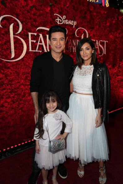 """Mario Lopez, Courtney Laine Mazza and Gia Francesca Lopez arrive for the world premiere of Disney's live-action """"Beauty and the Beast"""" at the El Capitan Theatre in Hollywood as the cast and filmmakers continue their worldwide publicity tour. (Photo: Alex J. Berliner/ABImages)"""