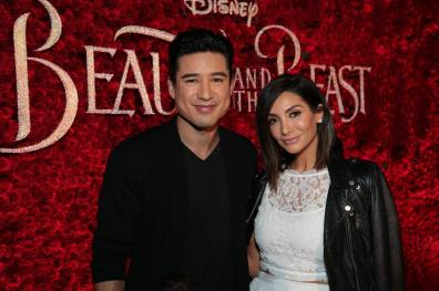 "Mario Lopez and Courtney Laine Mazza arrive for the world premiere of Disney's live-action ""Beauty and the Beast"" at the El Capitan Theatre in Hollywood as the cast and filmmakers continue their worldwide publicity tour. (Photo: Alex J. Berliner/ABImages)"