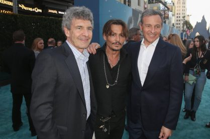 "HOLLYWOOD, CA - MAY 18: (L-R) Chairman, The Walt Disney Studios, Alan Horn, Actor Johnny Depp and The Walt Disney Company Chairman and CEO Bob Iger at the Premiere of Disney's and Jerry Bruckheimer Films' ""Pirates of the Caribbean: Dead Men Tell No Tales,"" at the Dolby Theatre in Hollywood, CA with Johnny Depp as the one-and-only Captain Jack in a rollicking new tale of the high seas infused with the elements of fantasy, humor and action that have resulted in an international phenomenon for the past 13 years. May 18, 2017 in Hollywood, California. (Photo by Jesse Grant/Getty Images for Disney) *** Local Caption *** Alan Horn; Johnny Depp; Bob Iger"