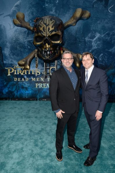 """HOLLYWOOD, CA - MAY 18: Executive producer Chad Oman (L) and EVP Production, The Walt Disney Company, Sam Dickerman at the Premiere of Disney's and Jerry Bruckheimer Films' """"Pirates of the Caribbean: Dead Men Tell No Tales,"""" at the Dolby Theatre in Hollywood, CA with Johnny Depp as the one-and-only Captain Jack in a rollicking new tale of the high seas infused with the elements of fantasy, humor and action that have resulted in an international phenomenon for the past 13 years. May 18, 2017 in Hollywood, California. (Photo by Marc Flores/Getty Images for Disney) *** Local Caption *** Chad Oman; Sam Dickerman"""