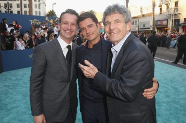 """HOLLYWOOD, CA - MAY 18: (L-R) President of Walt Disney Studios Motion Picture Production, Sean Bailey, Actor Orlando Bloom and Chairman, The Walt Disney Studios, Alan Horn at the Premiere of Disney's and Jerry Bruckheimer Films' """"Pirates of the Caribbean: Dead Men Tell No Tales,"""" at the Dolby Theatre in Hollywood, CA with Johnny Depp as the one-and-only Captain Jack in a rollicking new tale of the high seas infused with the elements of fantasy, humor and action that have resulted in an international phenomenon for the past 13 years. May 18, 2017 in Hollywood, California. (Photo by Jesse Grant/Getty Images for Disney) *** Local Caption *** Sean Bailey; Orlando Bloom; Alan Horn"""