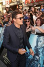 """HOLLYWOOD, CA - MAY 18: Actor Orlando Bloom at the Premiere of Disney's and Jerry Bruckheimer Films' """"Pirates of the Caribbean: Dead Men Tell No Tales,"""" at the Dolby Theatre in Hollywood, CA with Johnny Depp as the one-and-only Captain Jack in a rollicking new tale of the high seas infused with the elements of fantasy, humor and action that have resulted in an international phenomenon for the past 13 years. May 18, 2017 in Hollywood, California. (Photo by Jesse Grant/Getty Images for Disney) *** Local Caption *** Orlando Bloom"""