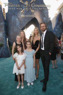 """HOLLYWOOD, CA - MAY 18: Director Joachim Ronning (R) and family at the Premiere of Disney's and Jerry Bruckheimer Films' """"Pirates of the Caribbean: Dead Men Tell No Tales,"""" at the Dolby Theatre in Hollywood, CA with Johnny Depp as the one-and-only Captain Jack in a rollicking new tale of the high seas infused with the elements of fantasy, humor and action that have resulted in an international phenomenon for the past 13 years. May 18, 2017 in Hollywood, California. (Photo by Jesse Grant/Getty Images for Disney) *** Local Caption *** Joachim Ronning"""