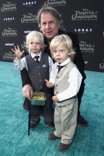 """HOLLYWOOD, CA - MAY 18: Writer Terry Rossio (C) and family at the Premiere of Disney's and Jerry Bruckheimer Films' """"Pirates of the Caribbean: Dead Men Tell No Tales,"""" at the Dolby Theatre in Hollywood, CA with Johnny Depp as the one-and-only Captain Jack in a rollicking new tale of the high seas infused with the elements of fantasy, humor and action that have resulted in an international phenomenon for the past 13 years. May 18, 2017 in Hollywood, California. (Photo by Rich Polk/Getty Images for Disney) *** Local Caption *** Terry Rossio"""