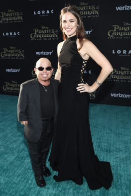 """HOLLYWOOD, CA - MAY 18: Actor Martin Klebba (L) and Michelle Dilgard at the Premiere of Disney's and Jerry Bruckheimer Films' """"Pirates of the Caribbean: Dead Men Tell No Tales,"""" at the Dolby Theatre in Hollywood, CA with Johnny Depp as the one-and-only Captain Jack in a rollicking new tale of the high seas infused with the elements of fantasy, humor and action that have resulted in an international phenomenon for the past 13 years. May 18, 2017 in Hollywood, California. (Photo by Rich Polk/Getty Images for Disney) *** Local Caption *** Martin Klebba; Michelle Dilgard"""