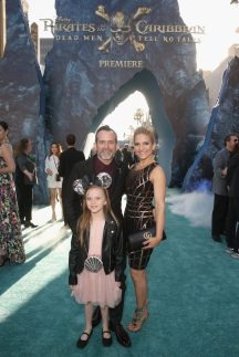 """HOLLYWOOD, CA - MAY 18: Composer Geoff Zanelli (L) and family at the Premiere of Disney's and Jerry Bruckheimer Films' """"Pirates of the Caribbean: Dead Men Tell No Tales,"""" at the Dolby Theatre in Hollywood, CA with Johnny Depp as the one-and-only Captain Jack in a rollicking new tale of the high seas infused with the elements of fantasy, humor and action that have resulted in an international phenomenon for the past 13 years. May 18, 2017 in Hollywood, California. (Photo by Jesse Grant/Getty Images for Disney) *** Local Caption *** Geoff Zanelli"""