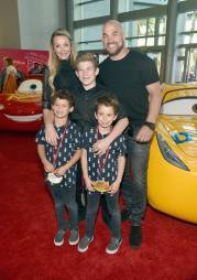 """ANAHEIM, CA - JUNE 10: Actor Amber Nichole Miller (back L), retired mixed martial artist Tito Ortiz (back R), and guests pose at the World Premiere of Disney/Pixarís ìCars 3"""" at the Anaheim Convention Center on June 10, 2017 in Anaheim, California. (Photo by Alberto E. Rodriguez/Getty Images for Disney) *** Local Caption *** Amber Nichole Miller;Tito Ortiz"""