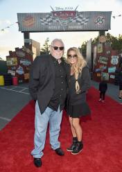 ANAHEIM, CA - JUNE 10: Actor John Ratzenberger (L) and Julie Blichfeldt pose at the after party for the World Premiere of Disney/Pixarís ìCars 3î at Cars Land at Disney California Adventure in Anaheim, CA. (Photo by Alberto E. Rodriguez/Getty Images for Disney) *** Local Caption *** John Ratzenberger;Julie Blichfeldt