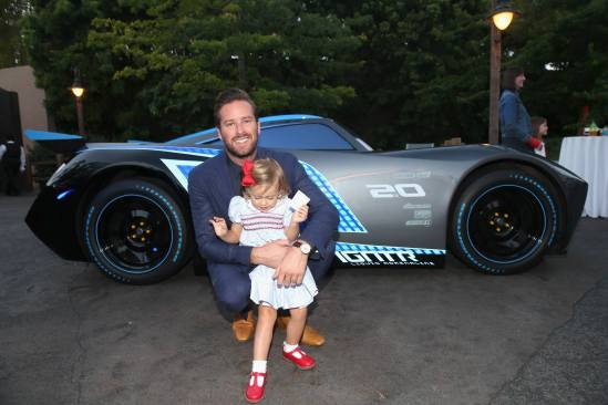 ANAHEIM, CA - JUNE 10: Actor Armie Hammer (back) and Harper Hammer pose at the after party for the World Premiere of Disney/Pixarís ìCars 3î at Cars Land at Disney California Adventure in Anaheim, CA. (Photo by Jesse Grant/Getty Images for Disney) *** Local Caption *** Armie Hammer;Harper Hammer