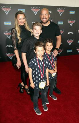"""ANAHEIM, CA - JUNE 10: Actor Amber Nichole Miller (back L), retired mixed martial artist Tito Ortiz (back R), and guests pose at the World Premiere of Disney/Pixarís ìCars 3"""" at the Anaheim Convention Center on June 10, 2017 in Anaheim, California. (Photo by Jesse Grant/Getty Images for Disney) *** Local Caption *** Amber Nichole Miller, Tito Ortiz"""