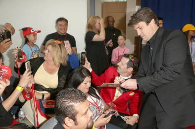 "ANAHEIM, CA - JUNE 10: Actor Nathan Fillion (R) signs autographs at the World Premiere of Disney/Pixarís ìCars 3"" at the Anaheim Convention Center on June 10, 2017 in Anaheim, California. (Photo by Jesse Grant/Getty Images for Disney) *** Local Caption *** Nathan Fillion"