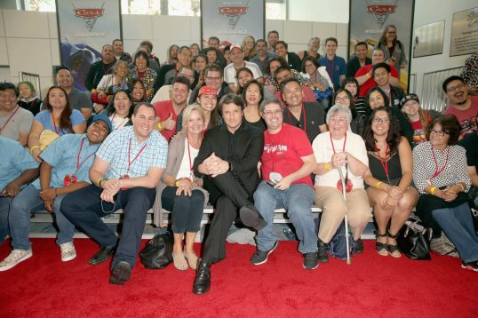 """ANAHEIM, CA - JUNE 10: Actor Nathan Fillion (C) poses with fans at the World Premiere of Disney/Pixarís ìCars 3"""" at the Anaheim Convention Center on June 10, 2017 in Anaheim, California. (Photo by Jesse Grant/Getty Images for Disney) *** Local Caption *** Nathan Fillion"""