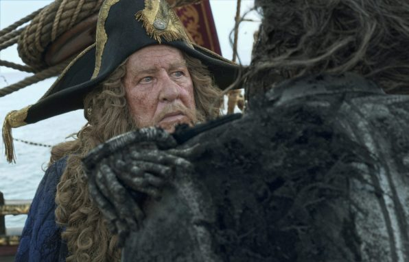 """PIRATES OF THE CARIBBEAN: DEAD MEN TELL NO TALES""..The villainous Captain Salazar (Javier Bardem) pursues Jack Sparrow (Johnny Depp) as he searches for the trident used by Poseidon...Pictured: Geoffrey Rush (Barbossa)..Ph: Film Frame..© Disney Enterprises, Inc. All Rights Reserved."