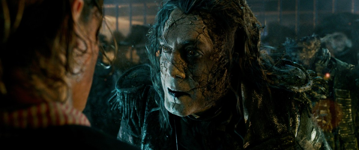 """PIRATES OF THE CARIBBEAN: DEAD MEN TELL NO TALES""..The villainous Captain Salazar (Javier Bardem) pursues Jack Sparrow (Johnny Depp) as he searches for the trident used by Poseidon...©Disney Enterprises, Inc. All Rights Reserved."