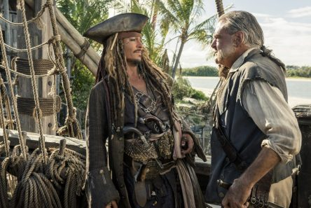 """PIRATES OF THE CARIBBEAN: DEAD MEN TELL NO TALES""..The villainous Captain Salazar (Javier Bardem) pursues Jack Sparrow (Johnny Depp) as he searches for the trident used by Poseidon..Pictured L to R: Captain Jack Sparrow (Johnny Depp) and Gibbs (Kevin McNally)..Ph: Peter Mountain..© Disney Enterprises, Inc. All Rights Reserved."