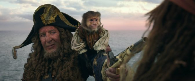 """PIRATES OF THE CARIBBEAN: DEAD MEN TELL NO TALES""..The villainous Captain Salazar (Javier Bardem) pursues Jack Sparrow (Johnny Depp) as he searches for the trident used by Poseidon..Pictured L to R: Captain Hector Barbossa (Geoffrey Rush) and Jack (Monkey)..Ph: Film Frame..© Disney Enterprises, Inc. All Rights Reserved."