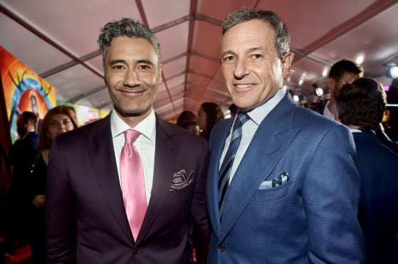 """HOLLYWOOD, CA - OCTOBER 10: Director Taika Waititi (L) and The Walt Disney Company Chairman and CEO, Bob Iger at The World Premiere of Marvel Studios' """"Thor: Ragnarok"""" at the El Capitan Theatre on October 10, 2017 in Hollywood, California. (Photo by Alberto E. Rodriguez/Getty Images for Disney) *** Local Caption *** Taika Waititi; Bob Iger"""