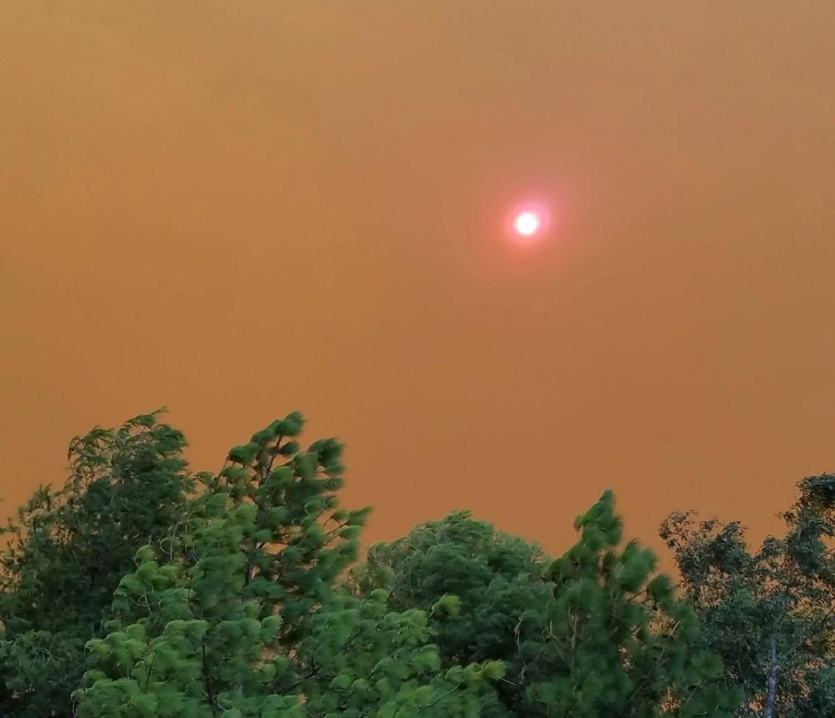 Anaheim Hills Fire Smoke over Disneyland Resort - Courtesy of @distinct_worlds on Instagram.