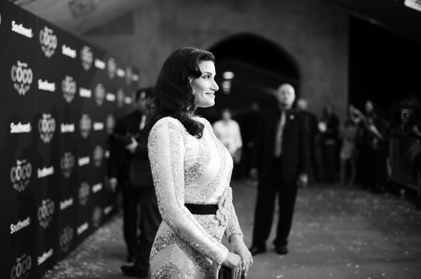 """HOLLYWOOD, CA - NOVEMBER 08: (EDITORS NOTE: Image has been converted to black and white) Actor Idina Menzel of """"Olafís Frozen Adventure"""" at the U.S. Premiere of Disney-Pixarís """"Coco"""" at the El Capitan Theatre on November 8, 2017, in Hollywood, California. """"Olafís Frozen Adventure"""" featurette opens in front of Disney-Pixarís original feature ìCocoî for a limited time. (Photo by Charley Gallay/Getty Images for Disney) *** Local Caption *** Idina Menzel"""
