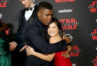 LOS ANGELES, CA - DECEMBER 09: Actors John Boyega (L) and Kelly Marie Tran at Star Wars: The Last Jedi Premiere at The Shrine Auditorium on December 9, 2017 in Los Angeles, California. (Photo by Jesse Grant/Getty Images for Disney) *** Local Caption *** John Boyega; Kelly Marie Tran