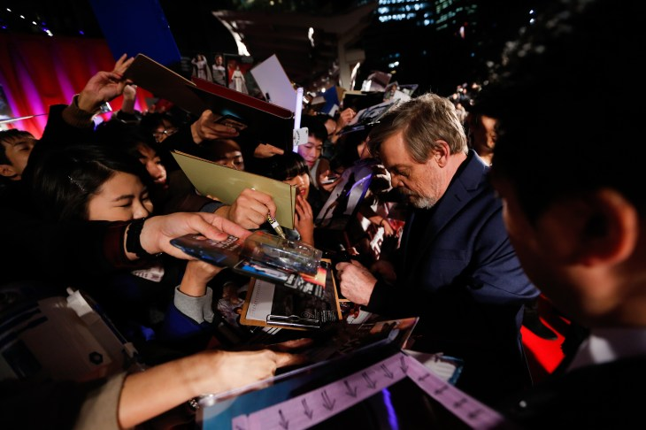 TOKYO, JAPAN - DECEMBER 06: (C) Mark Hamill signs autograph for fans during the 'Star Wars: The Last Jedi' Japan Premiere & Red Carpet at Roppongi Hills on December 6, 2017 in Tokyo, Japan. (Photo by Christopher Jue/Getty Images for Disney) *** Local Caption *** Mark Hamill