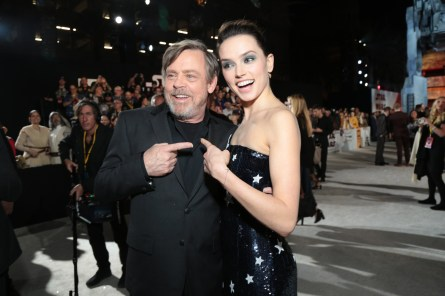 Mark Hamill and Daisy Ridley share a moment on the red carpet for the world premiere of LucasfilmÕs Star Wars: The Last Jedi at the Shrine Auditorium in Los Angeles, December 9, 2017..(Photo: Alex J. Berliner / ABImages )