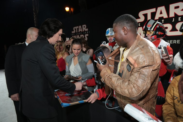 Adam Driver signs autographs with fans on the red carpet for the world premiere of LucasfilmÕs Star Wars: The Last Jedi at the Shrine Auditorium in Los Angeles, December 9, 2017..(Photo: Alex J. Berliner / ABImages )
