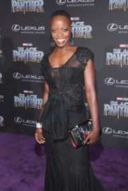 HOLLYWOOD, CA - JANUARY 29: Actor Florence Kasumba at the Los Angeles World Premiere of Marvel Studios' BLACK PANTHER at Dolby Theatre on January 29, 2018 in Hollywood, California. (Photo by Jesse Grant/Getty Images for Disney) *** Local Caption *** Florence Kasumba