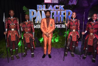 HOLLYWOOD, CA - JANUARY 29: Actor/singer Donald Glover (C) at the Los Angeles World Premiere of Marvel Studios' BLACK PANTHER at Dolby Theatre on January 29, 2018 in Hollywood, California. (Photo by Alberto E. Rodriguez/Getty Images for Disney) *** Local Caption *** Donald Glover; Childish Gambino