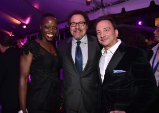 HOLLYWOOD, CA - JANUARY 29: (L-R) Actor Florence Kasumba, director/actor Jon Favreau, and producer Louis D'Esposito at the Los Angeles World Premiere of Marvel Studios' BLACK PANTHER at Dolby Theatre on January 29, 2018 in Hollywood, California. (Photo by Alberto E. Rodriguez/Getty Images for Disney) *** Local Caption *** Florence Kasumba; Jon Favreau; Louis D'Esposito