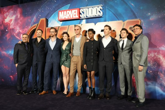 LONDON, ENGLAND - APRIL 08: (L-R) Joe Russo, Sebastian Stan, Tom Hiddleston, Elizabeth Olson, Paul Bettany, Letitia Wright, Benedict Cumberbatch, Tom Holland and Anthony Russo attend the UK Fan Event to celebrate the release of Marvel Studios' 'Avengers: Infinity War' at The London Television Centre on April 8, 2018 in London, England.