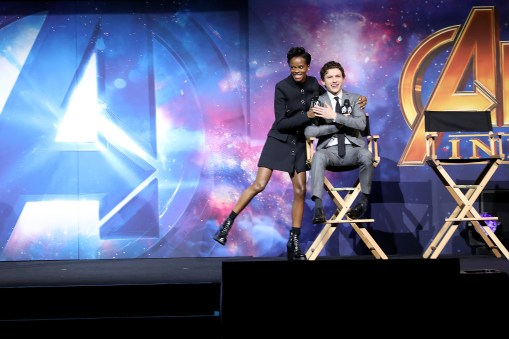 LONDON, ENGLAND - APRIL 08: Letitia Wright (L) and Tom Holland (R) attends the UK Fan Event to celebrate the release of Marvel Studios' 'Avengers: Infinity War' at The London Television Centre on April 8, 2018 in London, England.