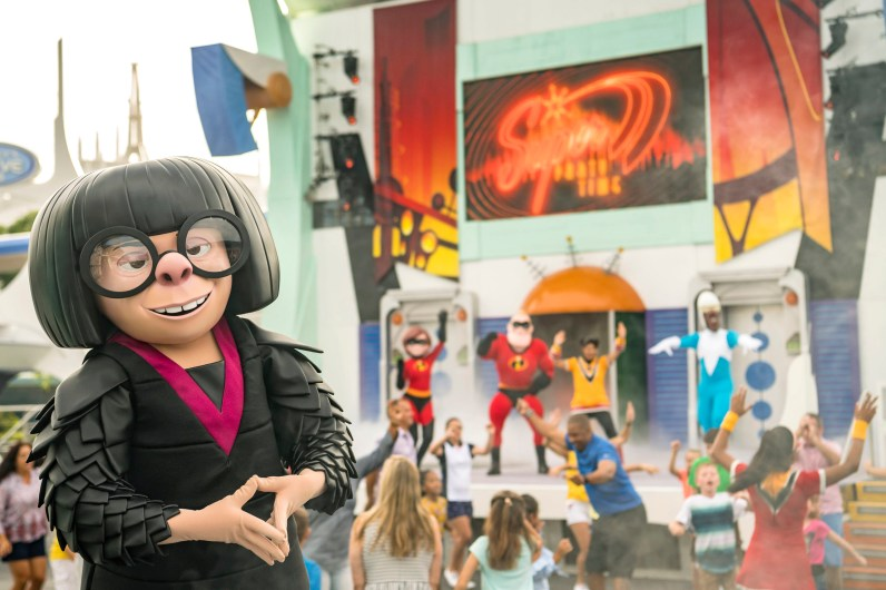 """Incredible Tomorrowland Expo, the celebration of all-things-super, welcomes Edna Mode – the """"legendary"""" costume designer for the Supers – to Magic Kingdom Park for the first time ever this summer. Mr. Incredible, Frozone, Mrs. Incredible and other characters from the Disney●Pixar film, """"The Incredibles,"""" and the upcoming """"Incredibles 2,"""" join together for an interactive celebration featuring incredible decor and high-energy music. Families can even get their groove on during """"Super Party Time,"""" a continuous dance party and show on the Rockettower Plaza Stage with themed games and engaging performances by up-and-coming Supers. (Matt Stroshane, photographer)"""