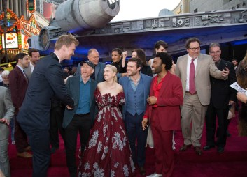 """Joonas Suotamo, Ron Howard, Emilia Clarke, Alden Enrenreich, Donald Glover and Jon Favreau attend the world premiere of """"Solo: A Star Wars Story"""" in Hollywood on May 10, 2018..(Photo: Alex J. Berliner/ABImages)."""