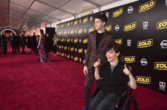 HOLLYWOOD, CA - MAY 10: Actors Mason Cook (L) and Micah Fowler attend the world premiere of ìSolo: A Star Wars Storyî in Hollywood on May 10, 2018. (Photo by Alberto E. Rodriguez/Getty Images for Disney) *** Local Caption *** Micah Fowler; Mason Cook
