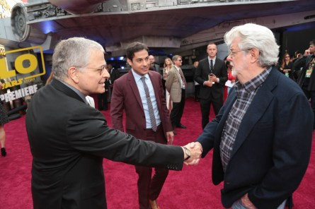 """Lawrence Kasdan and Jonathan Kasdan greet George Lucas at the world premiere of """"Solo: A Star Wars Story"""" in Hollywood on May 10, 2018. (Photo: Alex J. Berliner/ABImages)"""