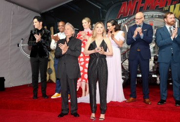 """HOLLYWOOD, CA - JUNE 25: (L-R) Actors David Dastmalchian, Tip """"T.I."""" Harris, Michael Douglas, Judy Greer, Michelle Pfeiffer, Hannah John-Kamen, Director Peyton Reed, and Producer Stephen Broussard attend the Los Angeles Global Premiere for Marvel Studios' """"Ant-Man And The Wasp"""" at the El Capitan Theatre on June 25, 2018 in Hollywood, California. (Photo by Jesse Grant/Getty Images for Disney) *** Local Caption *** David Dastmalchian; Tip """"T.I."""" Harris; Judy Greer; Hannah John-Kamen; Michael Douglas; Michelle Pfeiffer; Stephen Broussard; Peyton Reed"""