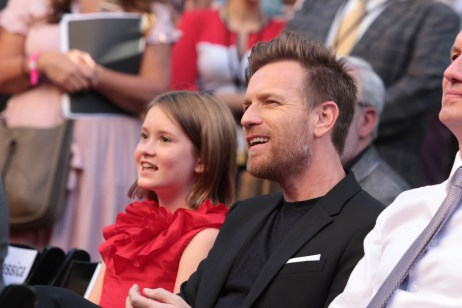 """Bronte Carmichael and Ewan McGregor listen on at the dedication and re-naming of the historic Orchestra Stage, now the Sherman Brothers Stage A, on the Disney Burbank lot prior to the world premiere of Disney's """"Christopher Robin"""" at the studio's Main Theater, on July 30, 2018 in Burbank, CA (Photo: Alex J. Berliner/ABImages)"""