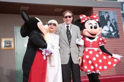 "Mickey Mouse, Elizabeth Sherman, Richard M. Sherman and Minnie Mouse share a moment at the dedication and re-naming of the historic Orchestra Stage, now the Sherman Brothers Stage A, on the Disney Burbank lot prior to the world premiere of Disney's ""Christopher Robin"" at the studio's Main Theater, on July 30, 2018 in Burbank, CA (Photo: Alex J. Berliner/ABImages)"