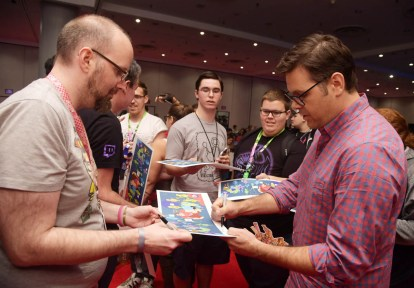 NEW YORK, NY - OCTOBER 05: Writer/director Phil Johnston signs a lithograph from the film following a conversation about RALPH BREAKS THE INTERNET at New York Comic Con at Jacob Javitz Center on October 5, 2018, in New York City. (Photo by Ben Gabbe/Getty Images for Disney Studios) *** Local Caption *** Phil Johnston