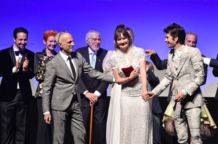 HOLLYWOOD, CA - NOVEMBER 29: (L-R) Actor Lin-Manuel Miranda, Costume Designer Sandy Powell, Producer John DeLuca, Actors Dick Van Dyke, Emily Mortimer, and Ben Whishaw onstage during Disney's 'Mary Poppins Returns' World Premiere at the Dolby Theatre on November 29, 2018 in Hollywood, California. (Photo by Alberto E. Rodriguez/Getty Images for Disney) *** Local Caption *** Lin-Manuel Miranda; Sandy Powell; John DeLuca; Dick Van Dyke; Emily Mortimer; Ben Whishaw