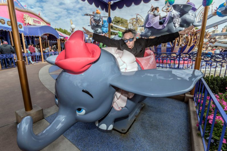Director Tim Burton poses with Dumbo the Flying Elephant at Disneyland Park in Anaheim, Calif., March 9, 2019, to celebrate the upcoming grand live-action adventure ÒDumbo,Ó in theaters March 29. For a limited time, a sneak peek of the film can be seen in the Main Street Opera House at Disneyland Park. (Joshua Sudock/Disneyland Resort)