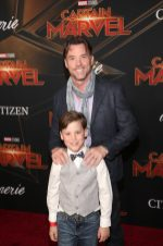 """HOLLYWOOD, CA - MARCH 04: Terry Notary and son attend the Los Angeles World Premiere of Marvel Studios' """"Captain Marvel"""" at Dolby Theatre on March 4, 2019 in Hollywood, California. (Photo by Jesse Grant/Getty Images for Disney) *** Local Caption *** Terry Notary"""