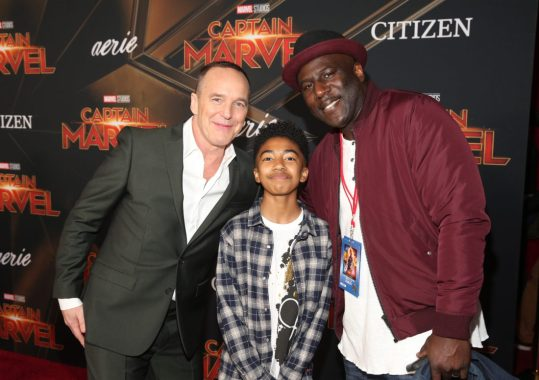 """HOLLYWOOD, CA - MARCH 04: (L-R) Actors Clark Gregg, Miles Brown and Wild Child attend the Los Angeles World Premiere of Marvel Studios' """"Captain Marvel"""" at Dolby Theatre on March 4, 2019 in Hollywood, California. (Photo by Jesse Grant/Getty Images for Disney) *** Local Caption *** Clark Gregg; Miles Brown; Wild Child"""