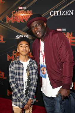 """HOLLYWOOD, CA - MARCH 04: Miles Brown (L) and father Wild Child attend the Los Angeles World Premiere of Marvel Studios' """"Captain Marvel"""" at Dolby Theatre on March 4, 2019 in Hollywood, California. (Photo by Jesse Grant/Getty Images for Disney) *** Local Caption *** Wild Child; Miles Brown"""