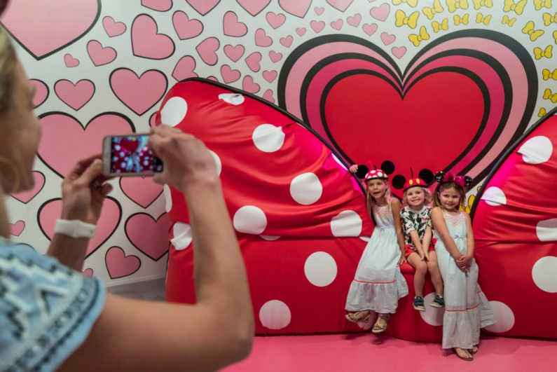Pop-Up Disney! A Mickey Celebration in the Downtown Disney District at the Disneyland Resort is a must-see experience celebrating 90 years of the beloved Mickey Mouse. This limited-time pop-up offering features selfie-and-photo-worthy, immersive and imaginatively-themed rooms inspired by all things Mickey Mouse. One fun surprise is a super-sized bow sofa (pictured). In this area, guests can pop into the portrait and take a seat on MinnieÕs plush sofa or pose under MinnieÕs giant bows and hearts. Pop-Up Disney! A Mickey Celebration requires a separate ticket. The Downtown Disney District is located in Anaheim, Calif. (Joshua Sudock/Disneyland Resort)