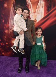 """LOS ANGELES, CA - MAY 21: Mena Massoud (C) and guests attend the World Premiere of Disney's """"Aladdin"""" at the El Capitan Theater in Hollywood CA on May 21, 2019, in the culmination of the film's Magic Carpet World Tour with stops in Paris, London, Berlin, Tokyo, Mexico City and Amman, Jordan. (Photo by Alberto E. Rodriguez/Getty Images for Disney) *** Local Caption *** Mena Massoud"""